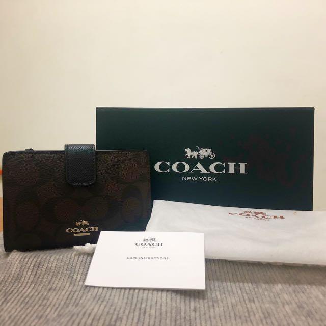 COACH PVC Logo內真皮釦式雙摺中夾
