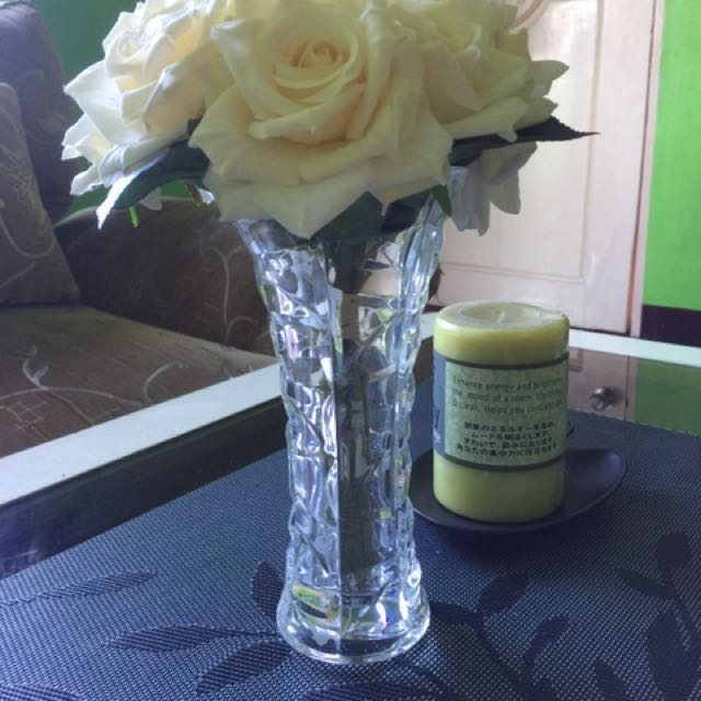 Flower vase with flowers for center / dining table