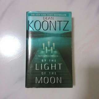 BY THE LIGHT OF THE MOON. THE NEW YORK TIMES BESTSELLER