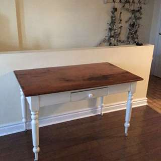 Cream distressed table 49 length 27 width 30 height