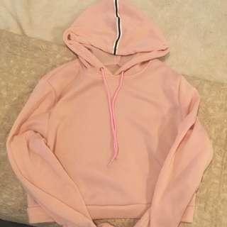 Pink cropped jumper with black line detail on hoodie