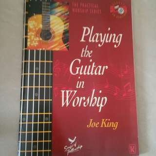 Playing guitar in worship