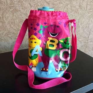 Barney sling bottle holder