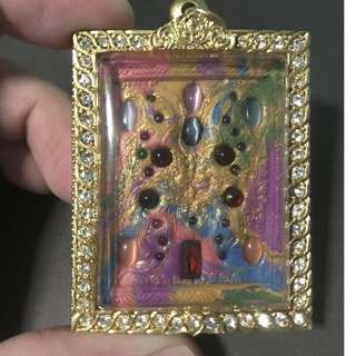 BE2560 Block Roman Butterfly Amulet with real sapphire gems, lots of cat eye gemstones in front and Gold Pidta at the back.