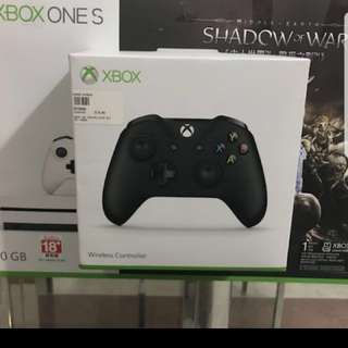 Xbox one s with additional controller.