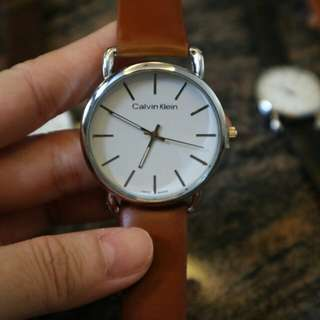 White Calvin Klein Brown Strap