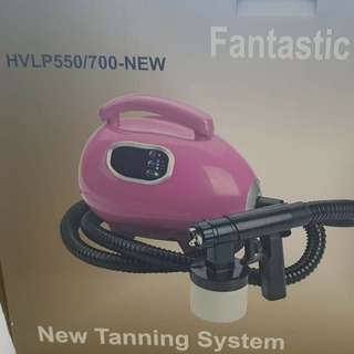 Spray tan machine with 1/4 bottle of St Tropez solution