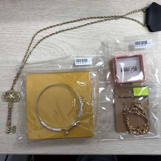Earrings, bangle, necklace, and ring