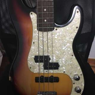 Electric bass guitar (Squier by Fender)