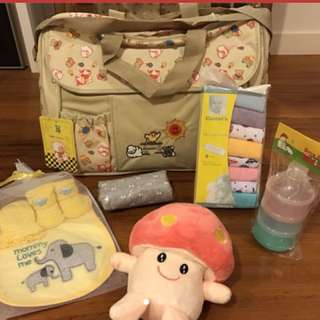 Maternity bag filled with Carter's Washcloths, Toy And Formula Dispenser