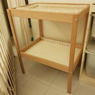 Baby changing table from Ikea includes changing mat