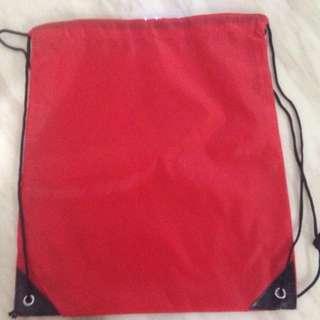 Red colour nylon drawstring bag