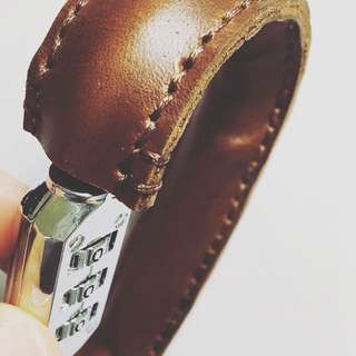 Leather wrapped carabiner lock (helmet lock)