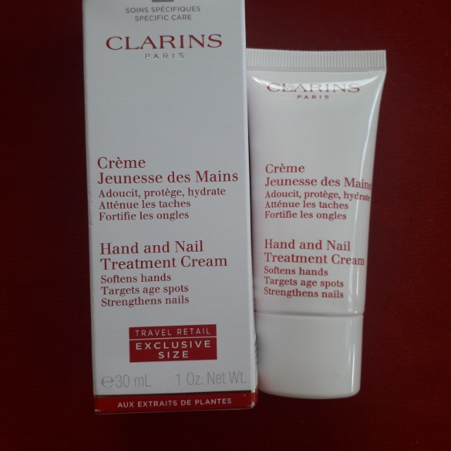 Clarins Hand and Nail treatment cream 30ml ( softens hands, targets age spots , strenghthens nails)