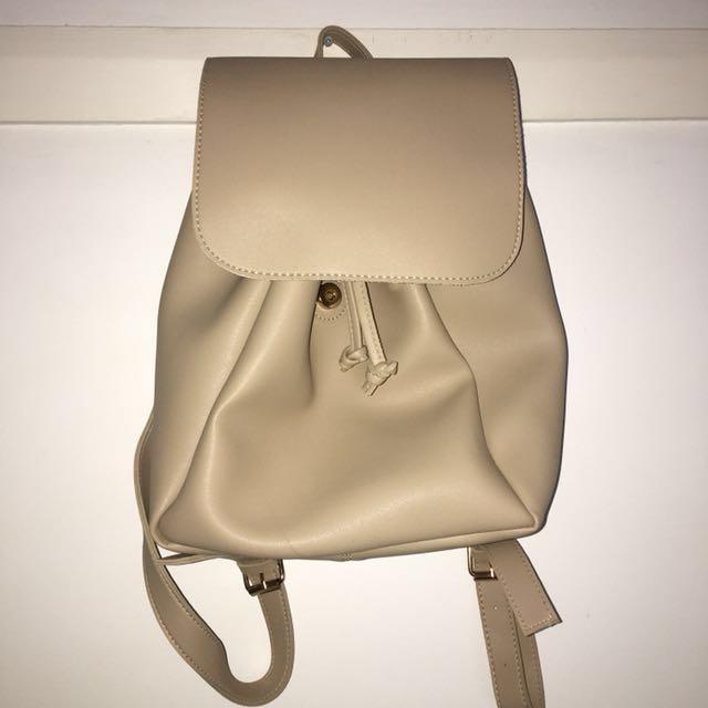 MINISO beige backpack