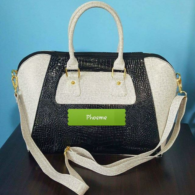 Phoeme hand bag with sling