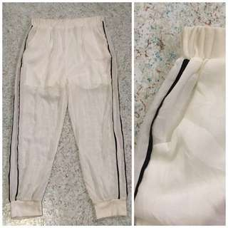 white jogger pants with inner short lining