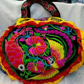 Embroidered traveling bag