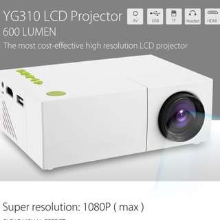 YG310 LCD Projector 600LM 320 x 240 1080P Mini Portable HD Movie LCD Projector Home Theater For Video Games TV Home Cinema