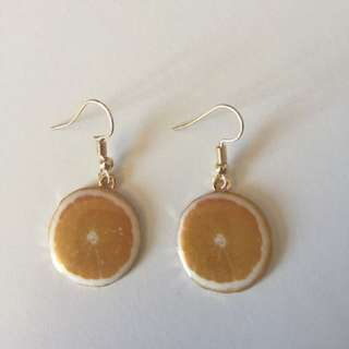 Orange dangly earings