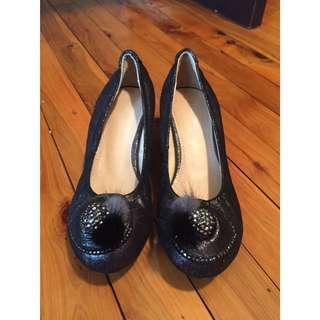 Flats with heel