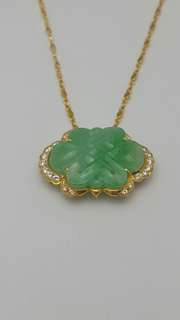 The jade cloud with 22 pic. full cut diamonds set in 20K yellow gold pendant.