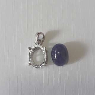 Tanzanite carbocheon/Pendant. Ready casing in 925 silver plated white gold to last. Natural non treated. Nice Blueish purple.