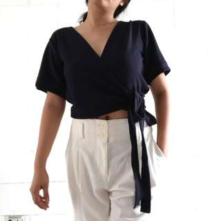 REPRICED! From p199. Tie- Front blouse plunging neckline.