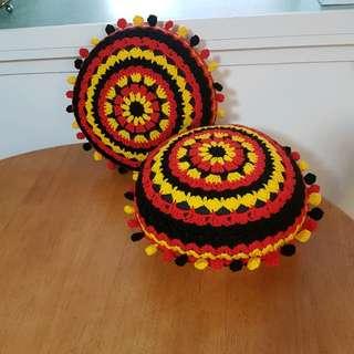 Crocheted pom pom cushions