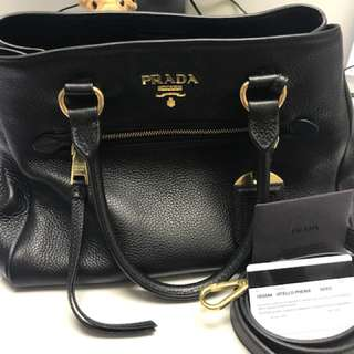 Prada Neto Leather Medium bag comes with sling strap