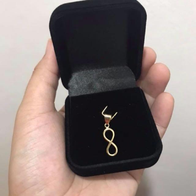18K saudi gold infinity pendant 0.5grams