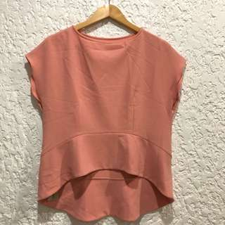 HARLAN HOLDEN Peplum Pitch Top in Salmon
