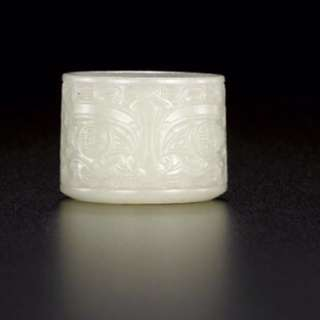 An imperial jade craving of a thumb ring  Qing dynasty. Qian Long period . Bought from Sotheby s HK  price on request