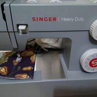 Singer model 4432 with free arm transparent table, still 1year warranty, seldom used
