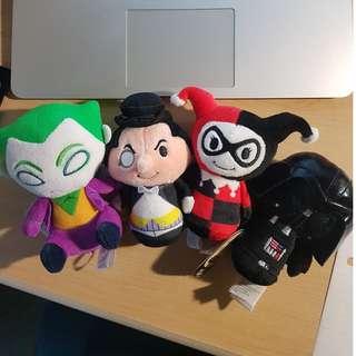 Joker, Penguin, Darth Vader, and Harley Plush toys