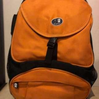 Backpack camera bag inside separate bag for lens