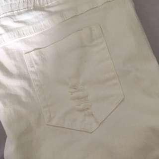 挖洞彈性牛仔褲