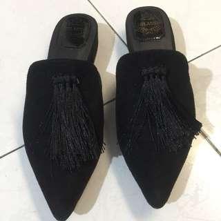 Black slip on with tassles