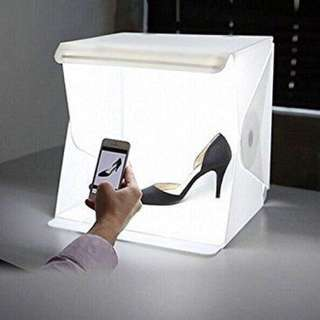 Portable photo studio with built in light