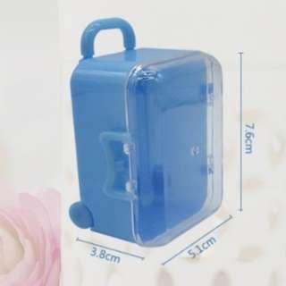 Luggage candy holder