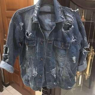 Oversized ripped blue denim jacket