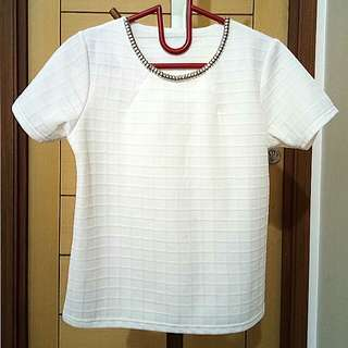 White necklace blouse