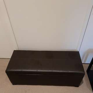Dark brown faux leather ottoman