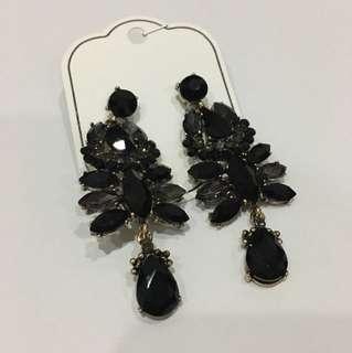Black bejewelled earrings