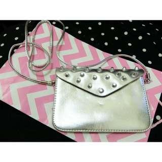 Silver studded sling bag