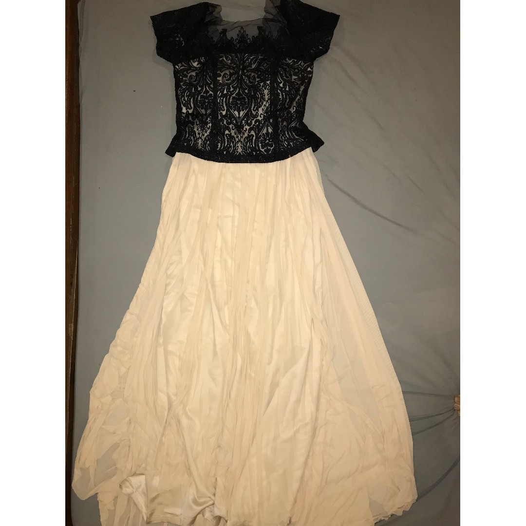 Gown with black lace top over nude flowy body