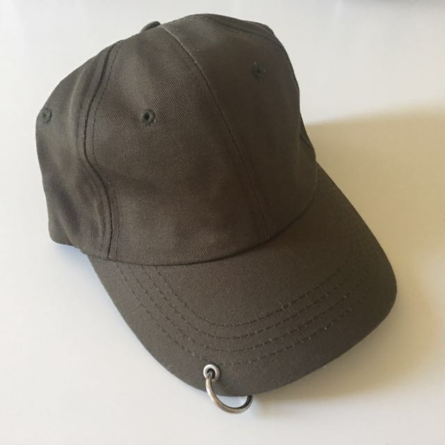 green cap/hat with a ring on