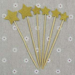Golden star birthday cake or cupcake topper