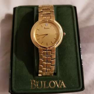 Men's Bulova gold watch with diamond.