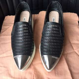 MiuMiu double perfo slip on black